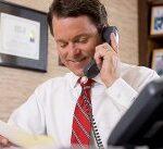 mark at desk on phone